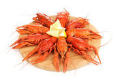 Tasty boiled crayfishes on chopping board isolated on white — Stock Photo