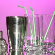 Cocktail shaker and glasses on color background - Stock Photo