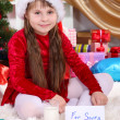Stock Photo: Beautiful little girl with milk and cookies for SantClaus in festively decorated room
