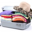 Closed silver suitcase with clothing isolated on white — Stock Photo #16775503