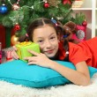 Little girl sleeping near christmas tree — Stock Photo #16775925