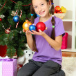 Stockfoto: Little girl decorating christmas tree