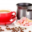 Red cup of coffee with rahat delight (locum) and coffee pot isolated on white — Stock Photo