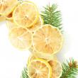 Christmas wreath of dried lemons with fir tree isolated on white - Zdjęcie stockowe