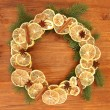 Royalty-Free Stock Photo: Christmas wreath of dried lemons with fir tree on wooden background