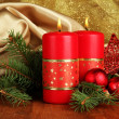 Two candles and christmas decorations, on golden cloth background - ストック写真