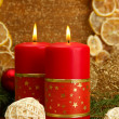 Two candles and christmas decorations, on golden background - Zdjęcie stockowe