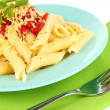 Rigatoni pasta dish with tomato sauce close up - Foto de Stock