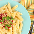 Rigatoni pasta dish with tomato sauce close up - Stock Photo