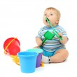 Little boy playing with plastic shovel, isolated on white — Stock Photo #16779291