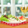 Stock Photo: Delicatessen seafood salad with rice in glass on bright background