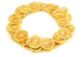 Christmas wreath of dried lemons isolated on white — ストック写真