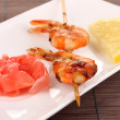 Stock Photo: Shrimp skewers on plate with ginger and lemon