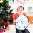 图库照片: Little boy with clock in anticipation of New Year