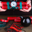 Stock Photo: Hummakes timebomb on wooden table on black background