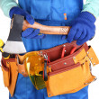 Male builder in blue overalls with hatchet isolated on white — Stock Photo