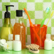 Stock Photo: Bath accessories on shelf in bathroom on green tile wall background