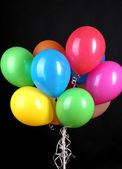 Colorful balloons isolated on black — Stock Photo