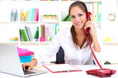 Young pretty business woman with phone and notebook working at office — Stock Photo
