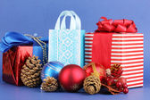 New Year composition of New Year's decor and gifts on blue background — Stock fotografie