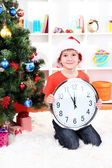 Little boy with clock in anticipation of New Year — Stok fotoğraf