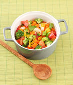 Vegetable stew in gray pot on bamboo mat background — Stockfoto