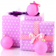 Colorful purple in peas gifts with pink Christmas balls isolated on white — Stock Photo #16839041