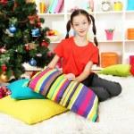 Little girl sitting near christmas tree — Stock Photo #16839725