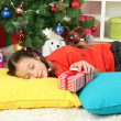 Little girl sleeping near christmas tree — Stock Photo #16839727