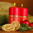 Stock Photo: Two candles and christmas decorations, on wooden background