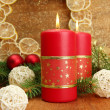 Two candles and christmas decorations, on golden background — Stock Photo #16839869