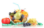 Glass bowl with fruit for diet and measuring tape isolated on white — Stock Photo