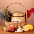 Honey and others natural medicine for winter flue, on wooden table on brown background — Stock Photo #16840167