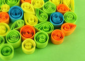 Colorful quilling on green background close-up — Zdjęcie stockowe
