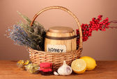 Honey and others natural medicine for winter flue, on wooden table on brown background — Stock Photo