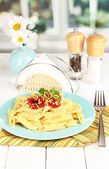 Rigatoni pasta dish with tomato sauce on white wooden table in cafe — Stock Photo