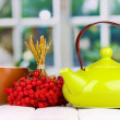 Tewith red viburnum on table on bright background — Stock Photo #16864907