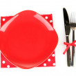 Empty red plate with fork and knife on colorful napkin, isolated on white — Stock Photo #16864961