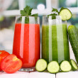 Fresh vegetable juices on wooden table, on window background — Stock Photo #16865417