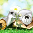 Garbage with growing flower. Environmental conservation concept — Stock Photo