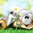 Garbage with growing flower. Environmental conservation concept — Stock Photo #16865565