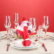Table setting in red tones on color background — Stock Photo #16865865