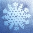 Stock Photo: Snowflake pattern on window