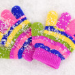Children's mittens in snow — Foto de Stock