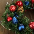 Beautiful Christmas wreath on wooden table close-up — Stock Photo