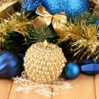 Stock Photo: Christmas composition with candles and decorations in blue and gold colors on wooden background