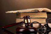 Gavel, handcuffs and book on law on brown background — Stock Photo