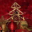 Christmas composition with candles and decorations in red and gold colors on bright background — Stock Photo #16875155