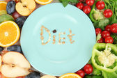 Blue plate surrounded by wholesome food diet close-up — Stock Photo