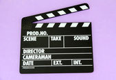 Movie production clapper board on color background — Stok fotoğraf